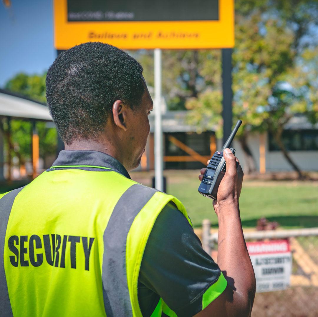 Professional security guard on radio